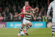 Dan Wishart (Forest Green Rovers) holds off Jon Parkin (York City) in midfield as York City ramp up the pressure on the visitors during the Vanarama National League match between York City and Forest Green Rovers at Bootham Crescent, York, England on 29 April 2017. Photo by Mark PDoherty.