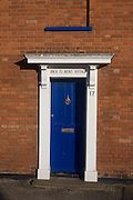 The Back to front cottage doorway at the Suffolk seaside town of Southwold, Suffolk.