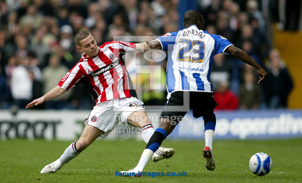 Sheffield - Saturday, January 19th, 2008: Jermaine Johnson of Sheffield Wednesday and Chris Armstrong of Sheffield United during the Coca Cola Champrionship match at Hillborough, Sheffield. (Pic by Paul Hollands/Focus Images)