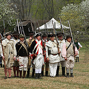A re-enactment of the American Revolution's Continental Army marching in Jockey Hollow National Park, New Jersey, USA. Parts of the Continental Army wintered in Jockey Hollow in 1779-1782.<br />
