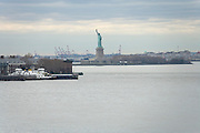 Statue of liberty seen from Brooklyn with Governors Island in the forground