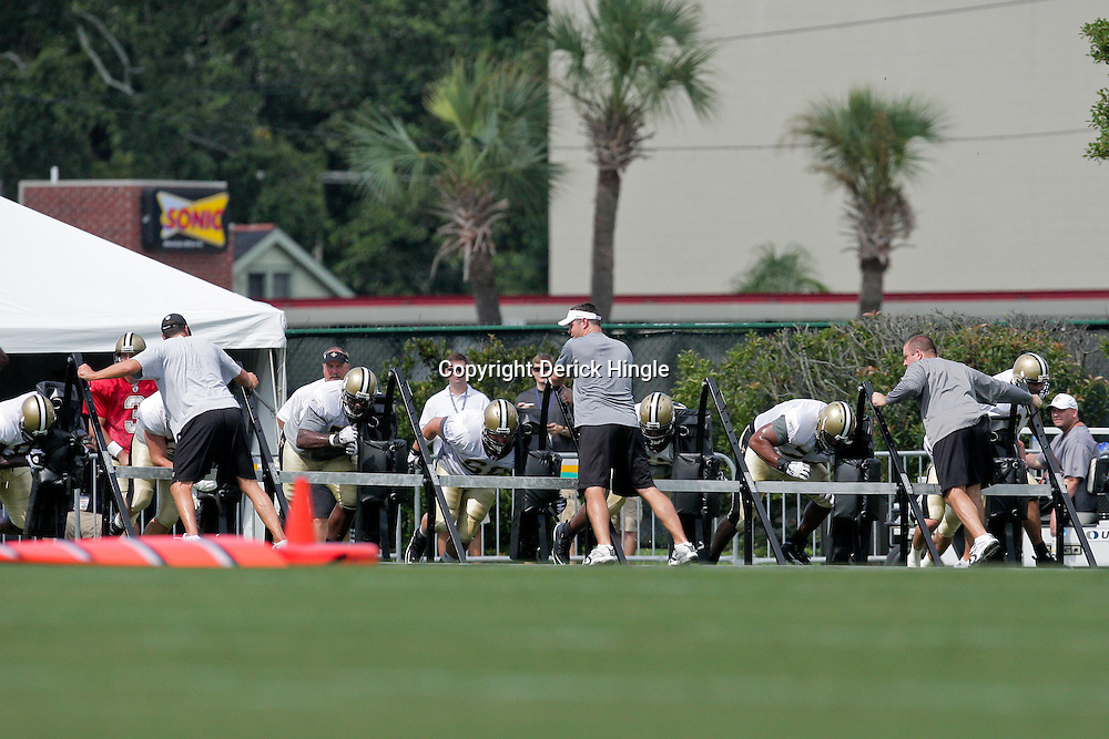 04 August 2009: Saints players workout with a sled drill during New Orleans Saints training camp at the team's practice facility in Metairie, Louisiana.
