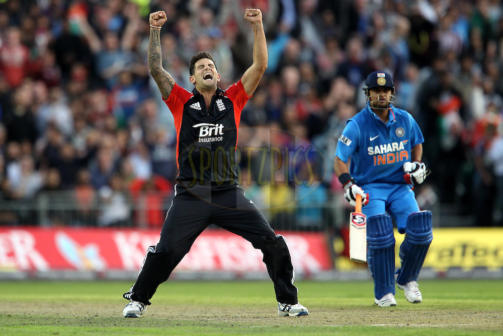 Jade Dernbach celebrates the wicket of India's MS Dhoni (Captain, WK) during the International T20 match between England and India held at The Old Trafford Cricket Ground in Manchester, England on the 31st August 2011...Photo by Ron Gaunt/SPORTZPICS/BCCI