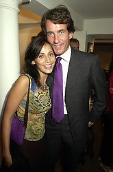Australian singer NATALIE IMBRUGLIA and TIM JEFFERIES, at an exhibition in London on 19th September 2000.OHB 105