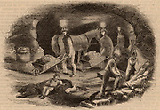 Hurlet alum mine near Glasgow, Scotland, showing miners extracting ore.  Light is provided by candles fixed to their helmets. From 'The Penny Magazine' (London, October 1843).  Engraving.