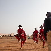 The girls of Malisadio women football team warming before second match of a national league, Malisadio against Amazones of Bacodjikoronì. Today is a derby, Malisadio team is from another Bamako district.