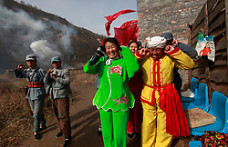 Actors dressed in traditional ethnic costumes and Chinese Communist red army uniforms cover their ears as pyrotechnics go off in a performance of the 'The Defense of Yan'an', a re-enactment of the 1947 Chinese civil war between the communists and nationalists in Yan'an, Shaanxi Province China, 03 November 2012. Tourists are able to dress up as red army soldiers and participate in the show for an extra 50 RMB (6.23 euros) on top of the 150 RMB entrance ticket. Yan'an is a former stronghold of the Chinese Communist Party where leader Mao Zedong and his comrades battle the Kuomintang forces while sheltering in hillside caves in the mountainous region from 1936 to 1948. The Chinese communist party is slated to hold its 18th national congress on 08 November where a major leadership transition will see current leaders President Hu Jintao and Premier Wen Jiabao make way for a new generation of leaders helmed by Xi Jinping, With more than 80 million members, the Chinese Communist Party is hard pressed to display a show of unity and power after  scandals the ousting of disgraced politician Bo Xilai roiled the country.