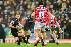 Gareth Steenson of Exeter Chiefs steps Tom Savage of Gloucester Rugby and Val Rapava Ruskin of Gloucester Rugby n,- Mandatory by-line: Ryan Hiscott/JMP - 24/11/2018 - RUGBY - Sandy Park Stadium - Exeter, England - Exeter Chiefs v Gloucester Rugby - Gallagher Premiership Rugby