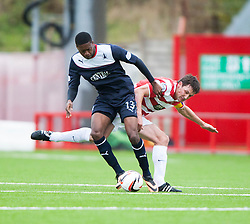 Falkirk's Rakish Bingham and Hamilton's Jason McGrath.<br /> Half time : Hamilton 1 v 0 Falkirk, Scottish Championship played today at New Douglas Park.<br /> &copy;Michael Schofield.