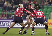 © Peter Spurrier/ Intersport Images.Photo Peter Spurrier.01/03/2003 Sport - Semi final Powergen Cup Rugby -.Leicester  v Gloucester - Franklin Gardens.Gloucester's Henry Paul and  Andy Hazell close the gap on lLeicester's Josh Kronfeld..