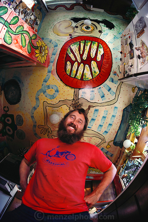 Artist Mark Bulwinkle in the kitchen of his home in Oakland, California, USA.  MODEL RELEASED. USA.