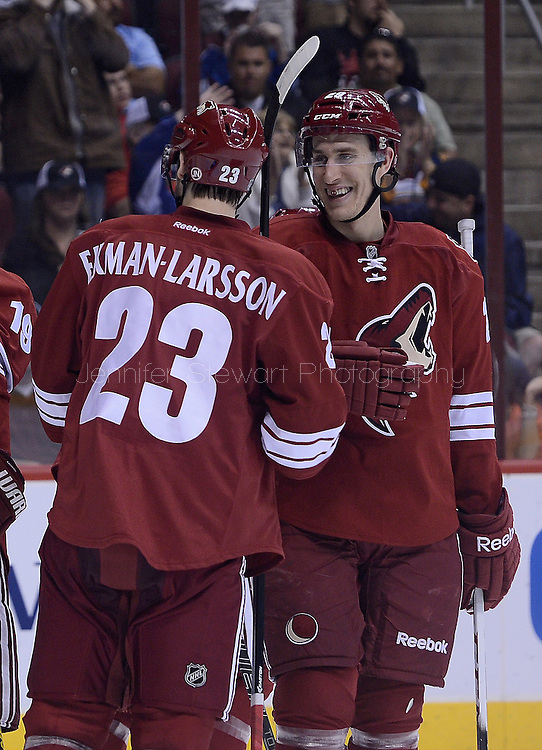 Apr. 6, 2013; Glendale, AZ, USA;  Phoenix Coyotes defenseman Michael Stone (29) and defenseman Oliver Ekman-Larsson (23) celebrate after right wing Shane Doan (not pictured) scores a goal in the second period against the Colorado Avalanche at Jobing.com Arena. Mandatory Credit: Jennifer Stewart-USA TODAY Sports