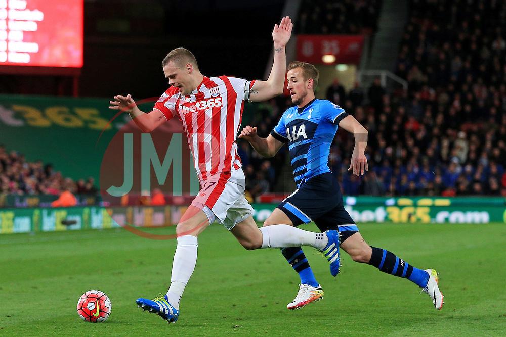 Ryan Shawcross of Stoke City is chased by Harry Kane of Tottenham Hotspur  - Mandatory by-line: Matt McNulty/JMP - 18/04/2016 - FOOTBALL - Britannia Stadium - Stoke, England - Stoke City v Tottenham Hotspur - Barclays Premier League