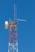 microwave and mobile radio antennas on red and white lattice tower in Jerilderie, New Soth Wales, Australia