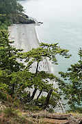 North Beach and Macs Cove in Deception Pass State Park, on Whidbey Island, Washington, USA. This is the most-visited State Park in Washington. Deception Pass connects Skagit Bay (part of Puget Sound) with the Strait of Juan de Fuca, which are all part of the Salish Sea.