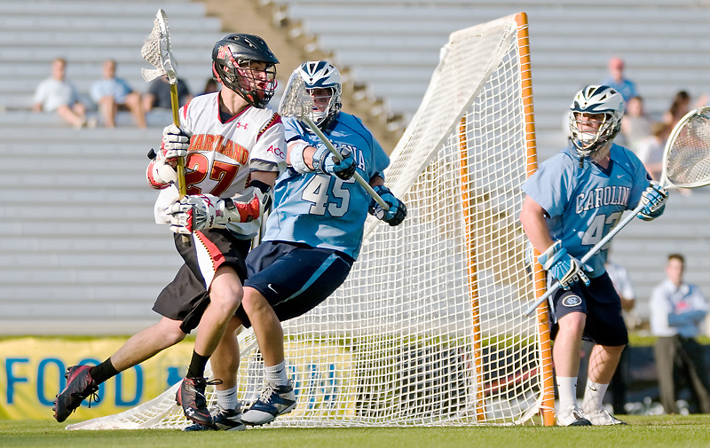 24 April 2009:Marylands sophomore attack #27 Ryan Young drives on UNC's Freshman defense #45 Charlie McComas.