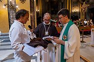 ROME, ITALY - JULY 15: Solemn Celebration and processions in honor of Madonna del Carmine in the Rione Borgo at Via della Conciliazione on July 15, 2018 in Rome, Italy. The statue of the Madonna weighing 15 quintals is carried by the bearers of the Venerable Confraternity of the Scapular of St. Mary of Mount Carmel, founded in 1527, in the church of Santa Maria in Traspontina .