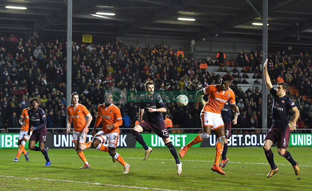 Blackpool's Armand Gnanduillet (second right) heads towards the goal but misses during the Emirates FA Cup, third round match at Bloomfield Road, Blackpool.