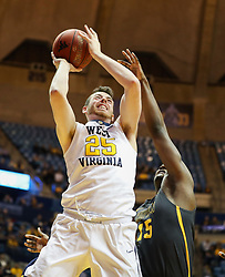Dec 20, 2017; Morgantown, WV, USA; West Virginia Mountaineers forward Maciej Bender (25) shoots in the lane during the second half against the Coppin State Eagles at WVU Coliseum. Mandatory Credit: Ben Queen-USA TODAY Sports