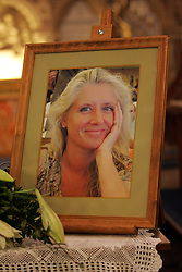 © under license to London News Pictures.  19/11/10..A picture of millionairess Joanna Brown, 46, is placed inside the church for her memorial service, St Mary's Church, Church Road, Winkfield, Berkshire. Joanna's body was found in woodland in Windsor Great Park on November 5th. Her husband, Robert Brown, also 46, has been charged with her murder. ..Picture credit should read: Rebecca Mckevitt/London News Pictures