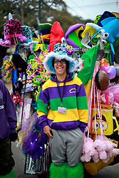 17 Feb 2015. New Orleans, Louisiana.<br /> Mardi Gras Day. A trinket Vendor prepares for Fat Tuesday sales on St Charles Avenue before the big parades start to roll.<br /> Photo; Charlie Varley/varleypix.com