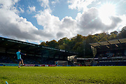 The sun shines down on Adams Park as a couple of players kick the ball around ahead of the EFL Sky Bet League 1 match between Wycombe Wanderers and Sunderland at Adams Park, High Wycombe, England on 19 October 2019.
