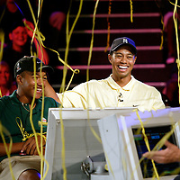 PGA golfer Tiger Woods, right, along with Robbie Biggers, 15, of Orlando, Fla, left, celebrate after winning at the Who Wants To Be A Millionaire-Play It! attraction on Tuesday, June 18, 2002 at the Disney-MGM Studios in Lake Buena Vista, Fla. Biggers is a member of the Orlando Minority Youth Golf Association and was on hand as a participant in the Tiger Woods Foundation Junior Golf Clinic held at Disney. (AP Photo/Scott Audette)