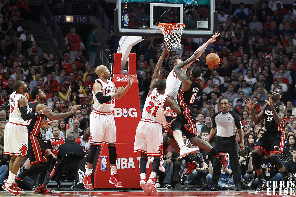 14 March 2012: Chicago Bulls center Omer Asik (3) blocks Miami Heat small forward LeBron James (6) shot during the Chicago Bulls 106-102 victory over the Miami Heat at the United Center, Chicago, Illinois, USA.