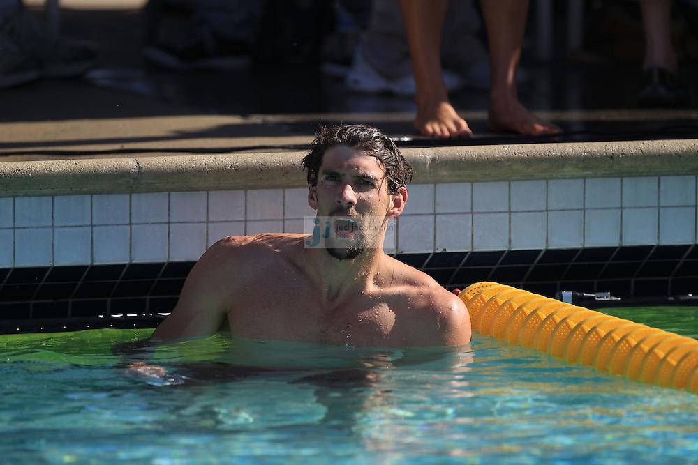SANTA CLARA, CA - JUNE 17:  Michael Phelps looks at his time during day 2 of the Santa Clara International Grand Prix at George F. Haines International Swim Center on June 17, 2011 in Santa Clara, California.  (Photo by Jed Jacobsohn)
