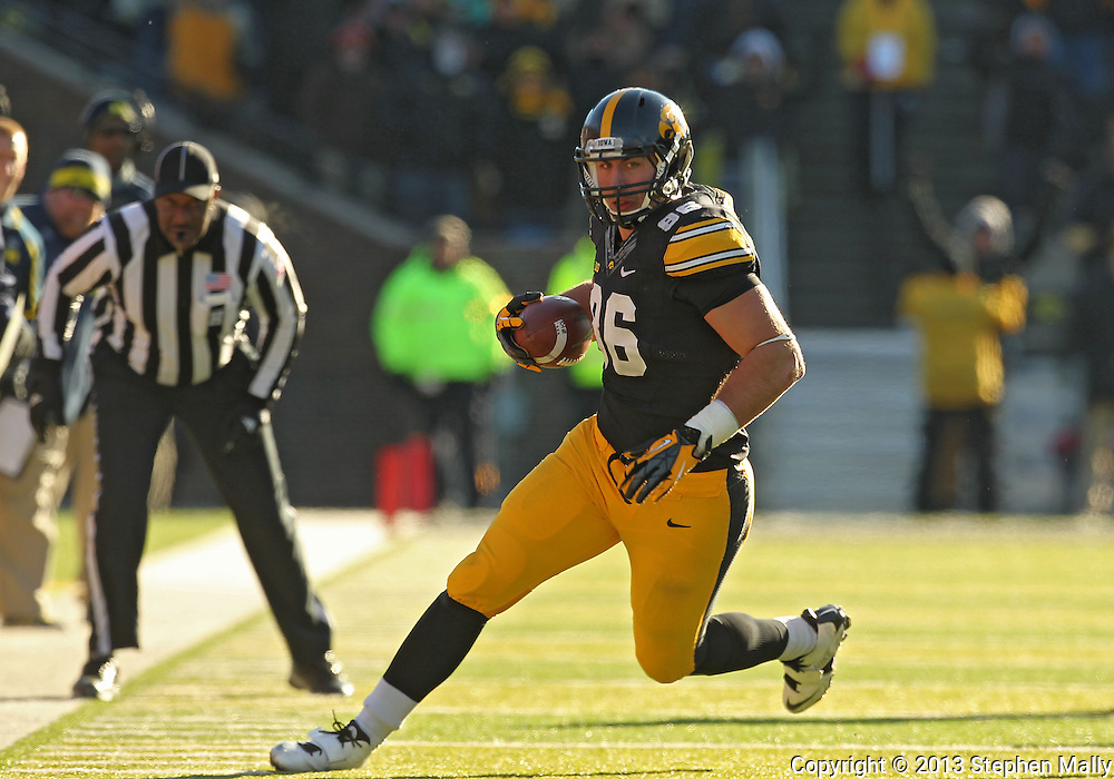 November 23 2013: Iowa Hawkeyes tight end C.J. Fiedorowicz (86) runs after a catch during the fourth quarter of the NCAA football game between the Michigan Wolverines and the Iowa Hawkeyes at Kinnick Stadium in Iowa City, Iowa on November 23, 2013. Iowa defeated Michigan 27-24. Iowa defeated Michigan 24-21.