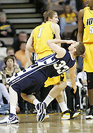 24 JANUARY 2007: Penn State guard Danny Morrissey (33) falls to the ground after getting poked in the eye by Iowa guard Adam Haluska (1) while fighting for the ball in Iowa's 79-63 win over Penn State at Carver-Hawkeye Arena in Iowa City, Iowa on January 24, 2007.