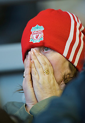 LIVERPOOL, ENGLAND - Saturday, January 30, 2010: A Liverpool supporter sees her side take on Bolton Wanderers in the Premiership match at Anfield. (Photo by: David Rawcliffe/Propaganda)
