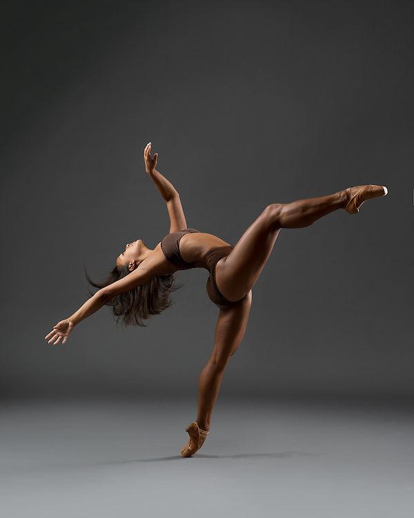 Contemporary ballet female dancer from Eryc Taylor Dance in nude. Photo taken in the photo studio on a dark background. Photograph taken in New York City by photographer Rachel Neville.