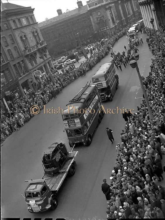 An old London Trolley Bus, an exhibit from the Transport Museum, took part in the Annual St. Patrick's Day Parade in Dublin. Thousands watched the Industrial Parade pass through the streets..17.03.1962