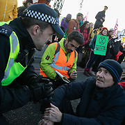 Thousands of Extinction Rebellion activists took over 5 bridges in Central London and blocked them for the day, November 17 2018, Central London, United Kingdom. Lambeth Bridge; activists preparing themselves to be arrested. Around 11am people on all bridges sat down in the road and blocked traffic from coming through and stayed till late afternoon. The actvists believe that the government is not doing enough to avoid catastrophic climate change and they demand the government take radical action to save future generations and the planet. Many are willing to be arrested peacefully protesting and up to 80 were arrested on the day.Extinction Rebellion is a grass root climate change group started in 2018 and has gained a huge following of people commited to peaceful protests and who ready to be arrested. Their major concern is that the world is facing catastropohic climate change and they want the British government to act now to save future generations.