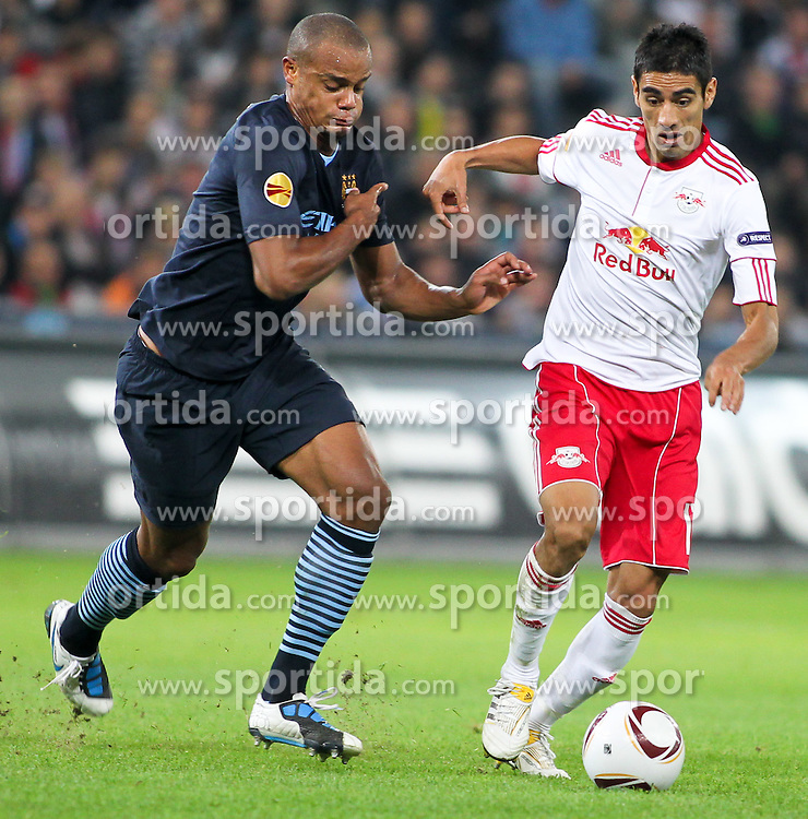 16.09.2010, Red Bull Arena, Salzburg, AUT, UEFA Euroleague , Red Bull Salzburg vs Manchester City, im Bild Gonzalo Zarate, (FC Red Bull Salzburg, Sturm, #11) und Vincent Kompany,(FC Manchester City, Defense, #4), EXPA Pictures © 2010, PhotoCredit: EXPA/ R. Hackl / SPORTIDA PHOTO AGENCY