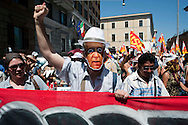 Roma 22 Giugno 2012.Manifestazione  dei sindacati di base contro le politiche economiche e sociali del Governo Monti..Manifestante con la maschera di Mario Monti.