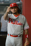 PHOENIX, AZ - JUNE 23:  Freddy Galvis #13 of the Philadelphia Phillies gestures to the camera while walking throught the dugout of the MLB game against the Arizona Diamondbacks at Chase Field on June 23, 2017 in Phoenix, Arizona. The Philadelphia Phillies won 6-1.  (Photo by Jennifer Stewart/Getty Images)
