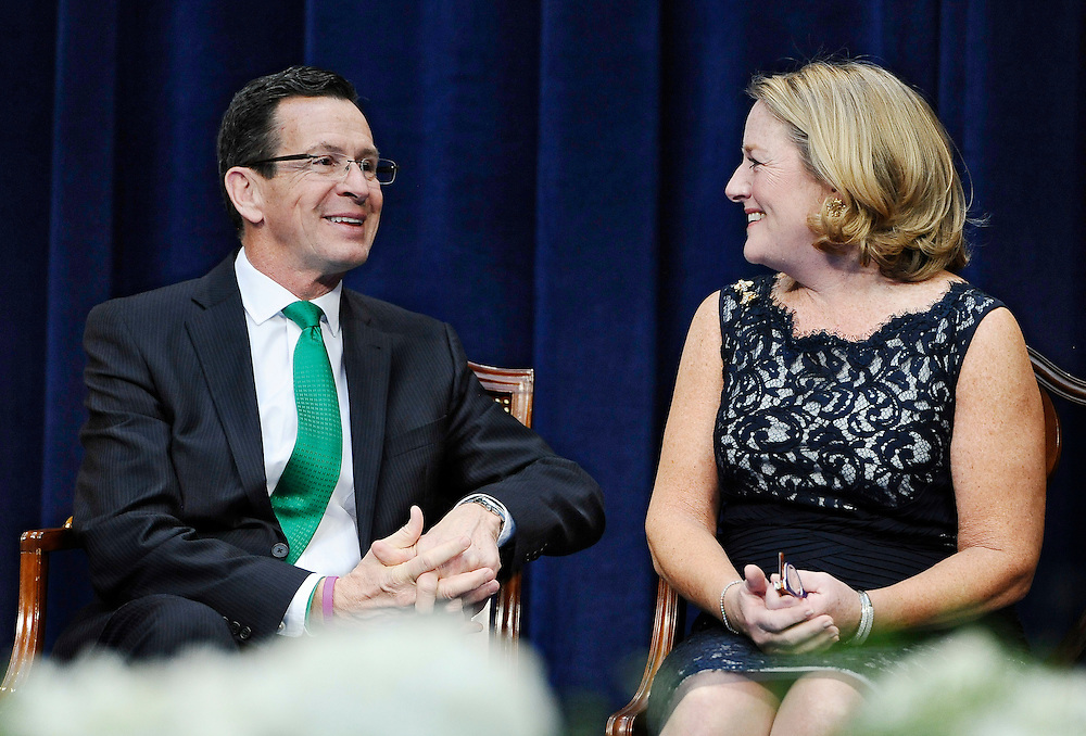 Connecticut Gov. Dannel P. Malloy, left, sits with wife Cathy Malloy after being sworn in for his second term, Wednesday, Jan. 7, 2015, inside the William A. O'Neill Armory in Hartford Conn. (AP Photo/Jessica Hill, Pool)
