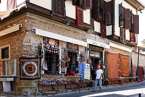 large shop, old building, Turkish textiles displayed, colorful, Kaleici neighborhood, Antalya, Turkey
