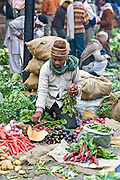 INDIA, NEW DELHI:  Vendor prepares his vegetables for sale in a busy street market in New Delhi.