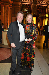 LOUISA GUINNESS and BEN BROWN at the inaugural dinner for The Queen Elizabeth Scholarship Trust hosted by Viscount Linley at the V&A museum, London on 25th February 2016.
