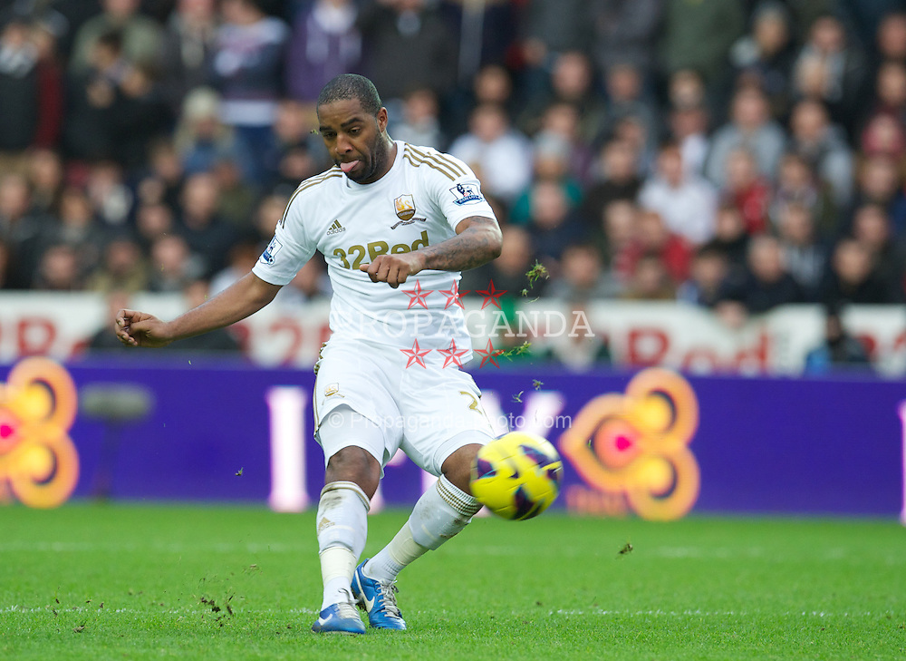 SWANSEA, WALES - Sunday, December 23, 2012: Swansea City's Kemy Agustien in action against Manchester United during the Premiership match at the Liberty Stadium. (Pic by David Rawcliffe/Propaganda)