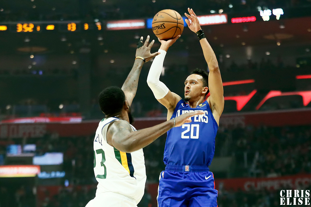 LOS ANGELES, CA - NOV 3: Landry Shamet (20) of the LA Clippers shoots the ball over Royce O'Neale (23) of the Utah Jazz during a game on November 3, 2019 at the Staples Center, in Los Angeles, California.