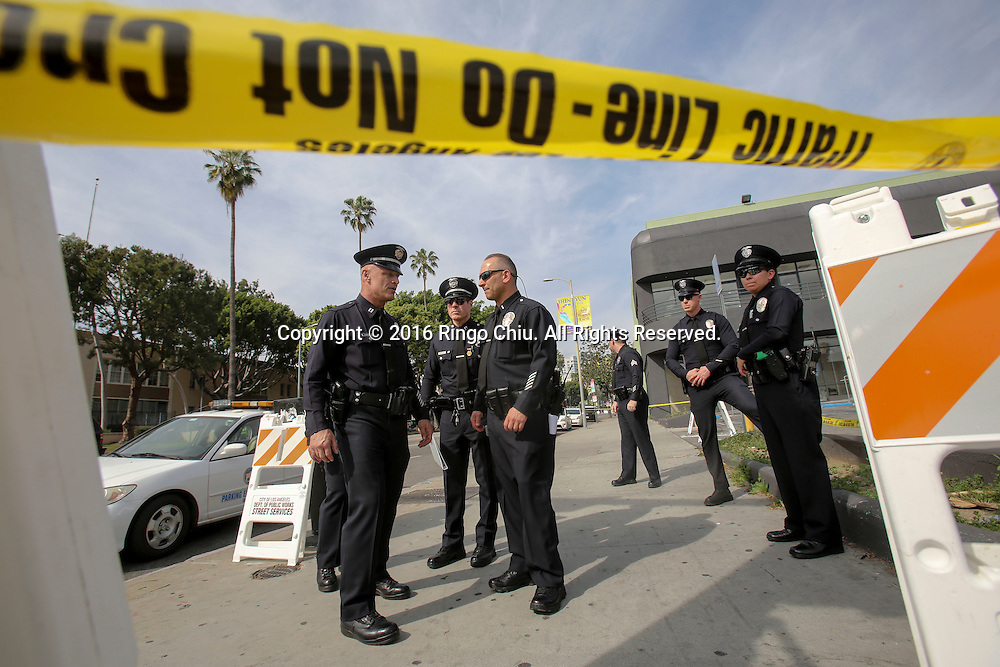 Police officers stand guard as a rally and march circle to protest the all-white slate of Oscar acting nominees and calling for more diversity in the entertainment industry, Sunday Feb. 28, 2016 in Los Angeles.(Photo by Ringo Chiu/PHOTOFORMULA.com)<br /> <br /> Usage Notes: This content is intended for editorial use only. For other uses, additional clearances may be required.
