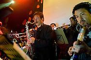 Band members play at La Juliana, a dance club in Quito, Ecuador.