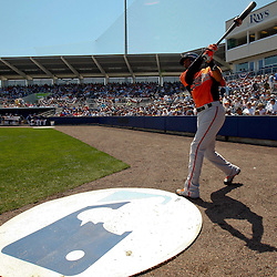 March 20, 2011; Port Charlotte, FL, USA; Baltimore Orioles center fielder Adam Jones (10) prepares to bat during a spring training exhibition game against the Tampa Bay Rays at Charlotte Sports Park.  Mandatory Credit: Derick E. Hingle-US PRESSWIRE