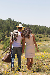 cowboy and girl walking together on a ranch in New Mexico