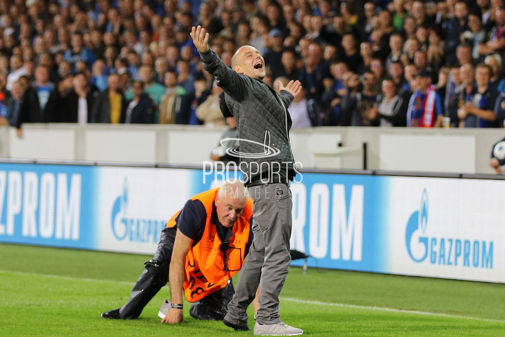 Manchester United fan on the pitch during the Champions League Qualifying Play-Off Round match between Club Brugge and Manchester United at the Jan Breydel Stadion, Brugge, Belguim on 26 August 2015. Photo by Phil Duncan.