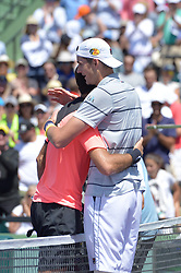 March 30, 2018 - Key Biscayne, FL, United States - KEY BISCAYNE, FL - MARCH 30: John Isner (USA) hugs Juan Martin Del Potro (ARG) at the net after defeating him during day 12 of the 2018 Miami Open held at the Crandon Park Tennis Center on March 29, 2018 in Key Biscayne, Florida  (Credit Image: © Andrew Patron via ZUMA Wire)